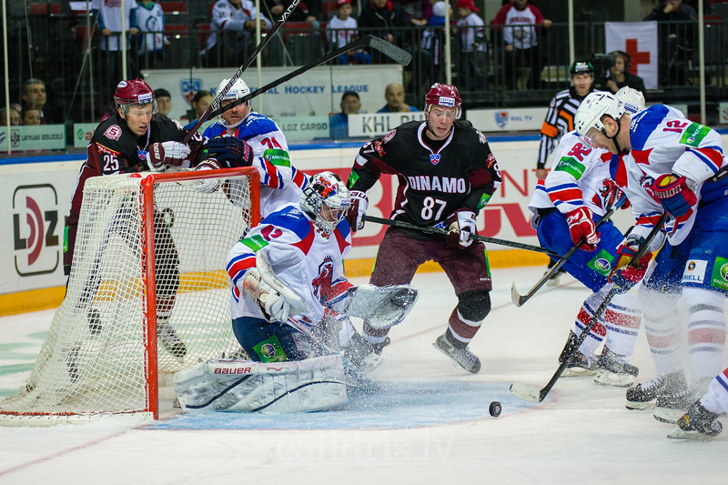 Jiri Novotny (12) kicks the puck out from the front of the goal