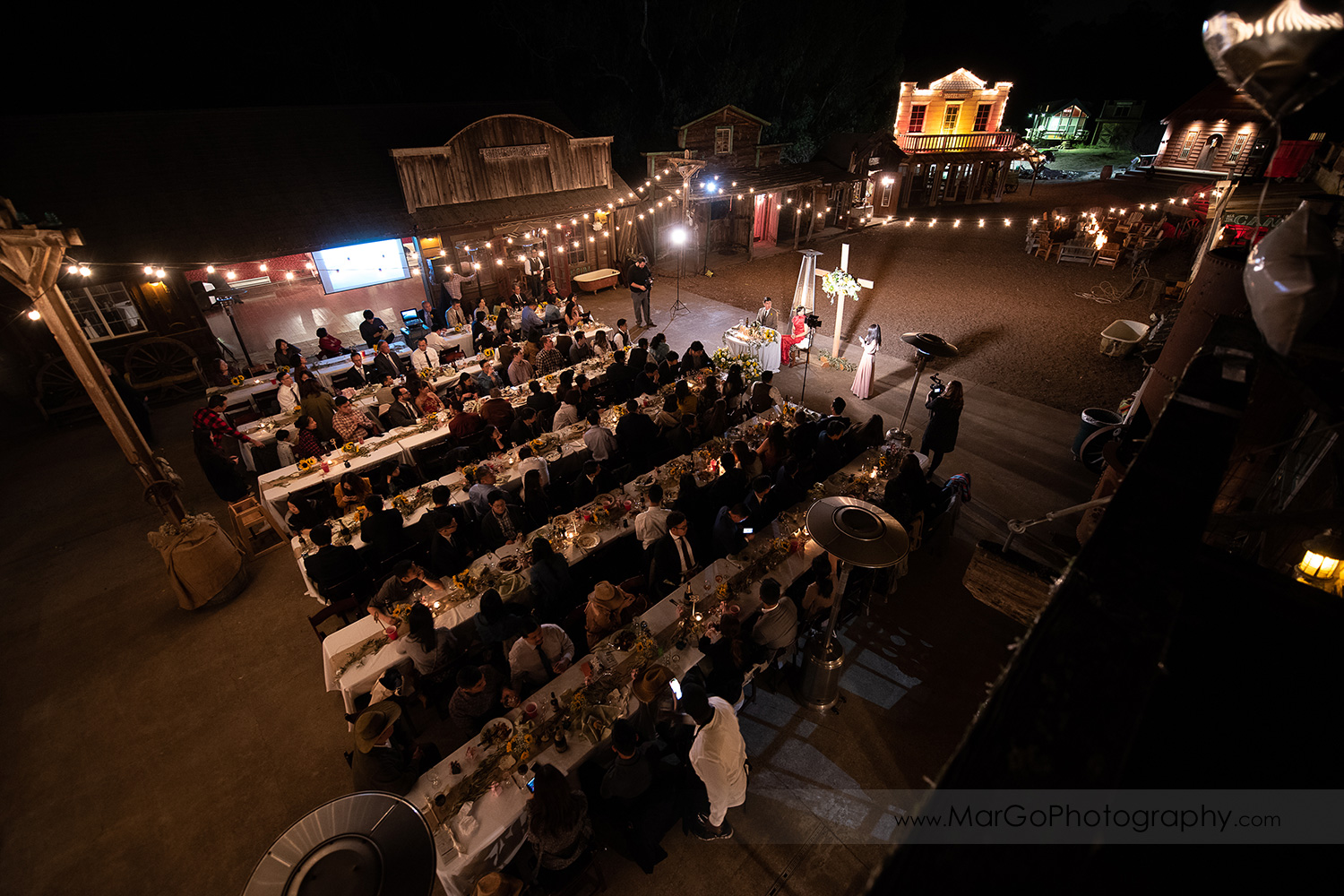 night high-angle shot of outdoor wedding reception at Long Branch Saloon & Farms in Half Moon Bay