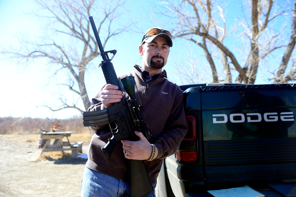 . ROCKY FORD, CO - FEBRUARY 25: Mac Holder shows off his AR-15 with a 30-round clip attached in Rocky Ford. Gun owners in southern Colorado largely agree that responsible ownership begins at home. (Photo by AAron Ontiveroz/The Denver Post)