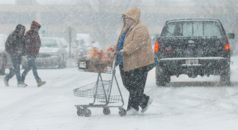Description of . Shoppers buy groceries at the Kroger's in West State Plaza on W. State Blvd during a snow storm in Fort Wayne, Ind., Wednesday, Dec. 26, 2012. (AP Photo/The Journal Gazette, Cathie Rowand)