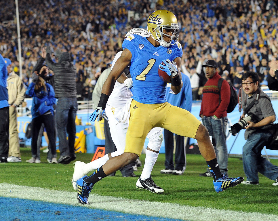 . UCLA�s Shaquelle Evans #1 scores on a 27-yard touchdown catch during their game against Arizona State at the Rose Bowl Saturday November 23, 2013. Arizona State beat UCLA 38-33. (Photos by Hans Gutknecht/Los Angeles Daily News)
