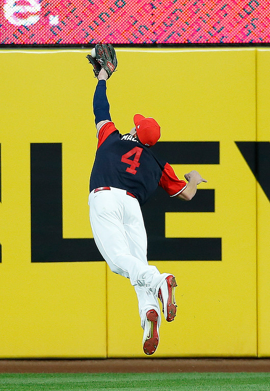 . Cleveland Indians\' Bradley Zimmer makes a diving catch to get out Kansas City Royals\' Lorenzo Cain during the fifth inning in a baseball game, Saturday, Aug. 26, 2017, in Cleveland. (AP Photo/Ron Schwane)