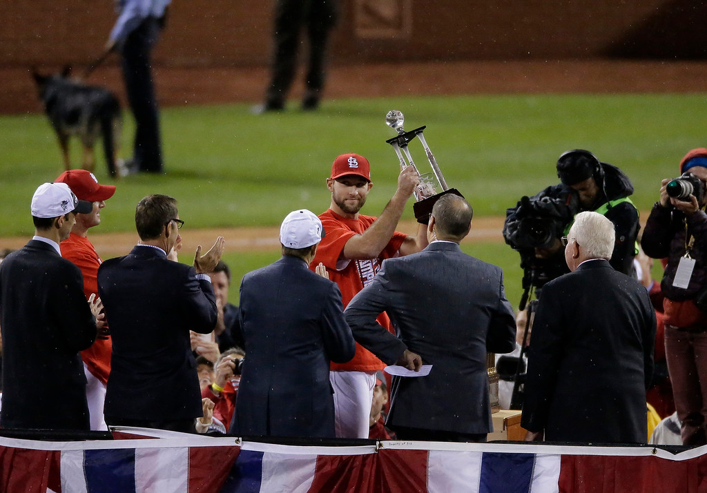. St. Louis Cardinals starting pitcher Michael Wacha holds up his MVP trophy after Game 6 of the National League baseball championship series against the Los Angeles Dodgers Friday, Oct. 18, 2013, in St. Louis. The Cardinals won 9-0 to win the series. (AP Photo/Chris Carlson)