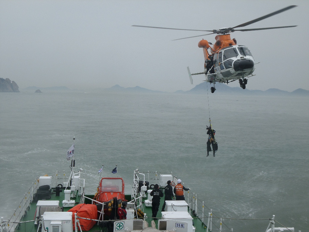 . In this handout image provided by the Republic of Korea Coast Guard, the rescue work by members of the Republic of Korea Coast Guard continues around the site of ferry sinking accident off the coast of Jindo Island on April 16, 2014 in Jindo-gun, South Korea.  (Photo by The Republic of Korea Coast Guard via Getty Images)