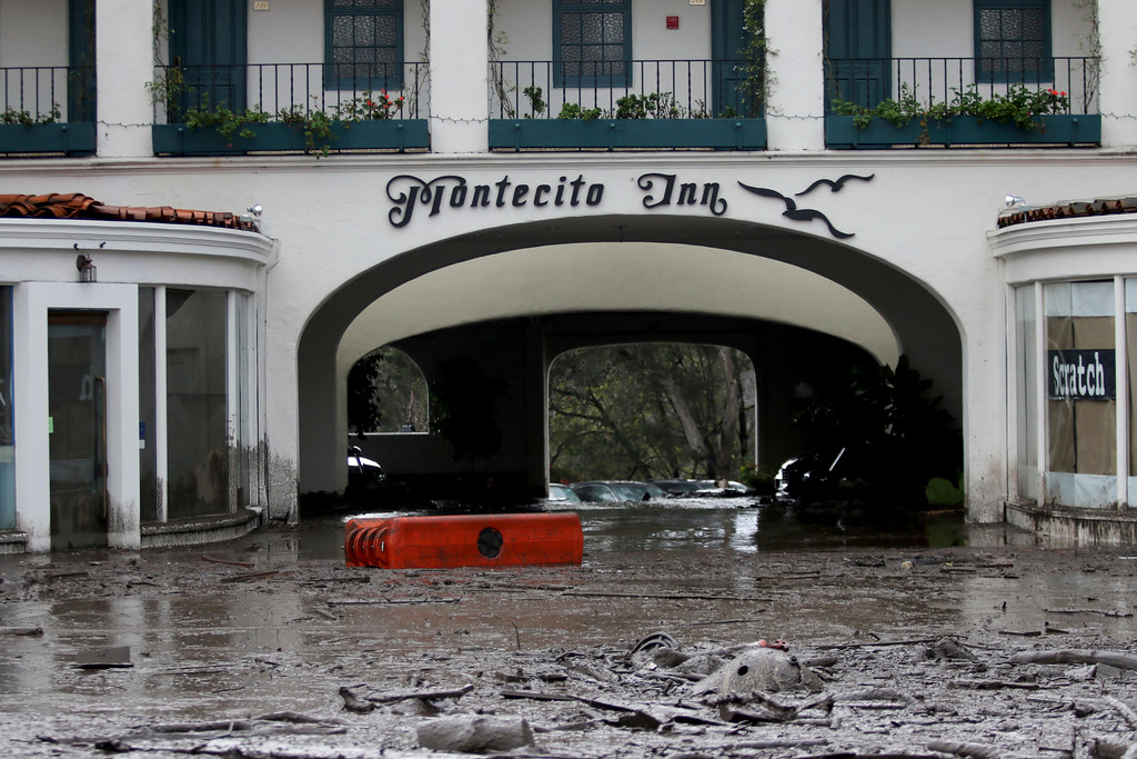 . Debris and mud cover the entrance of the Montecito Inn after heavy rain brought flash flooding and mudslides to the area in Montecito, Calif. on Tuesday, Jan. 9, 2018. At least five people were killed and homes were swept from their foundations Tuesday as heavy rain sent mud and boulders sliding down hills stripped of vegetation by a gigantic wildfire that raged in Southern California last month. (Daniel Dreifuss)
