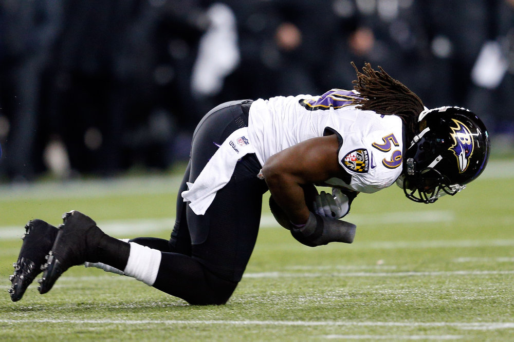 Description of . Dannell Ellerbe #59 of the Baltimore Ravens intercepts a pass by Tom Brady #12 of the New England Patriots in the fourth quarter during the 2013 AFC Championship game at Gillette Stadium on January 20, 2013 in Foxboro, Massachusetts.  (Photo by Jim Rogash/Getty Images)
