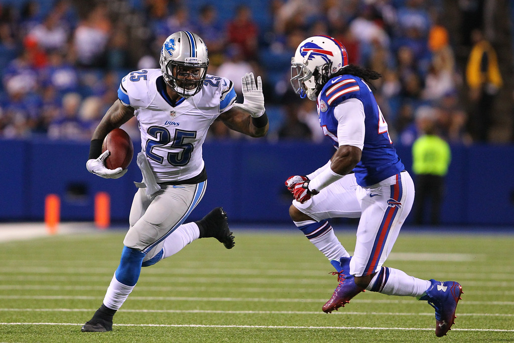 . Detroit Lions running back Mikel Leshoure (25) tries to stiff arm Buffalo Bills defensive back Kamaal McIlwain (41) during the second half of a preseason NFL football game, Thursday, Aug. 28, 2014, in Orchard Park, N.Y. (AP Photo/Bill Wippert)