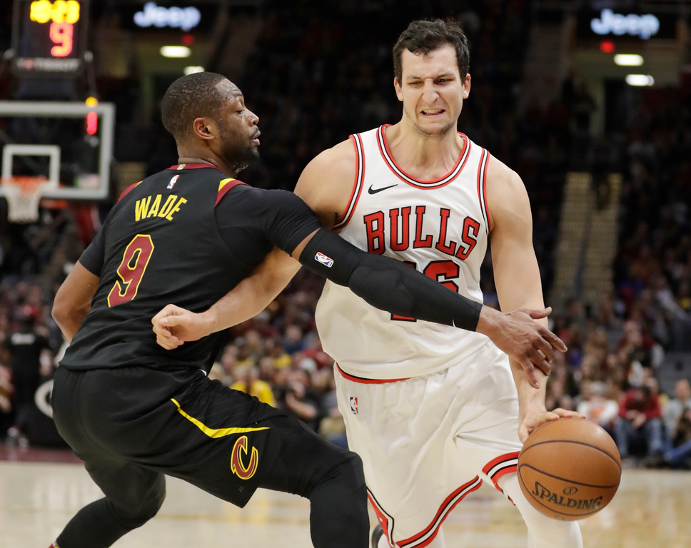 . Cleveland Cavaliers\' Dwyane Wade (9) knocks the ball from Chicago Bulls\' Paul Zipser (16), from Germany, during the second half of an NBA basketball game, Thursday, Dec. 21, 2017, in Cleveland. The Cavaliers won 115-112. (AP Photo/Tony Dejak)