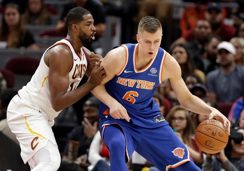 . New York Knicks\' Kristaps Porzingis (6), from Latvia, drives against Cleveland Cavaliers\' Tristan Thompson (13) in the first half of an NBA basketball game, Sunday, Oct. 29, 2017, in Cleveland. (AP Photo/Tony Dejak)