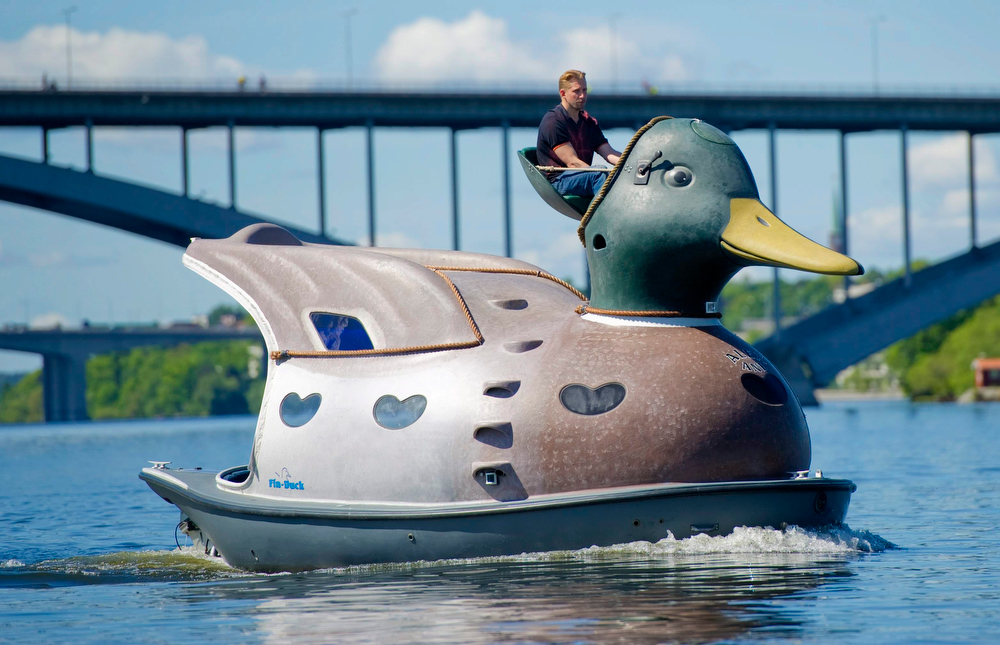 Description of . Shipwright Christian Bohlin steers his duck shaped boat across Stockholm harbour on May 27, 2011. The duck, one of two novelty boats built by Bohlin, contains two sleeping cots, a kitchenette and a sauna in the bow will be up for sale at the forthcoming boat expo in Sweden for around 40,000 euro (58,000 USD).  AFP PHOTO / SCANPIX-SWEDEN / FREDRIK SANDBERG