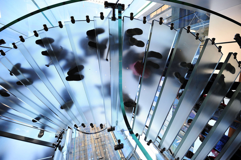 . People wanting to buy the Apple iPhone 5 walk down a circular stairway into the Apple Store on Fifth Avenue September 20, 2013 in New York. Some people waited as long as fifteen days in line outside the store to be the first to buy the phone. AFP PHOTO/Stan HONDA/AFP/Getty Images