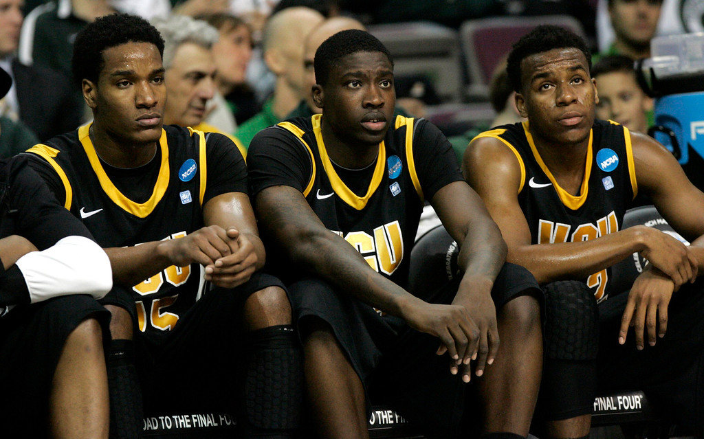 . VCU Rams Juvonte Reddic (L-R), Jarred Guest and Melvin Johnson react as they watch from the bench the final minutes of their third round NCAA tournament basketball game against Michigan Wolverines in Auburn Hills, Michigan March 23, 2013. REUTERS/ Rebecca Cook