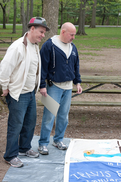 (1) Pslip Slug #: W 00020181; (2) Ridgewood, NJ; (3) 05/02/09; (4) AIDS Quilt Displayed at 11th Annual Rigewood AIDS Walk on 5/2/2009; (5) (L-R) NJ Buddies 2009 AIDS Walk chairman Mark Anderson and NJ Buddies Executive Director Steve Scheuermann consider one of the panels of the AIDS memorial quilt on display on 5/2/2009 at the Eleventh Annual NJB AIDS Walk; (6) W.H. Grae for the Ridgewood News.