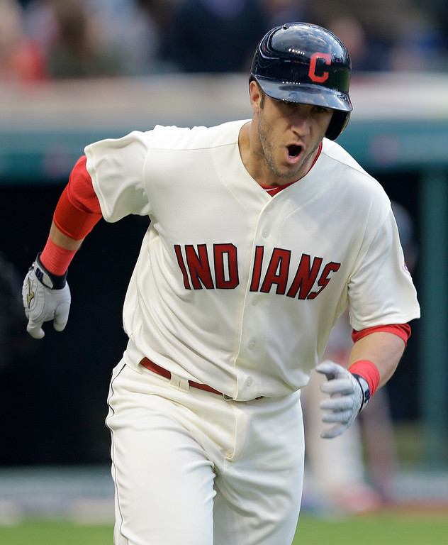 . Cleveland Indians\' Yan Gomes reacts after hitting a two-run home run off Minnesota Twins starting pitcher Ricky Nolasco in the second inning of a baseball game, Friday, May 13, 2016, in Cleveland. Jose Ramirez scored on the play. (AP Photo/Tony Dejak)