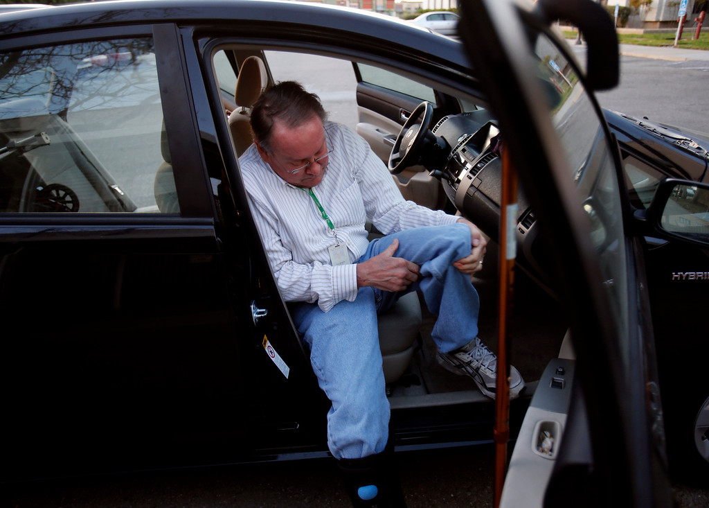 . Gary Richards gets into the passenger seat of their Toyota Prius as his wife Jan puts his walker in the trunk for their drive home from the San Jose Mercury News office in San Jose, Calif., on March 4, 2013.  Richards is writing a column about how he cannot drive for six to eight months while his right foot heals. The theme is how this affects the Merc\'s Mr. Roadshow columnist and now is an issue that many older motorists will be facing as our population ages and driving skills diminish.  His wife Jan must now drive him everywhere he needs to go, including to and from work until his foot heals.  (Nhat V. Meyer/Staff)