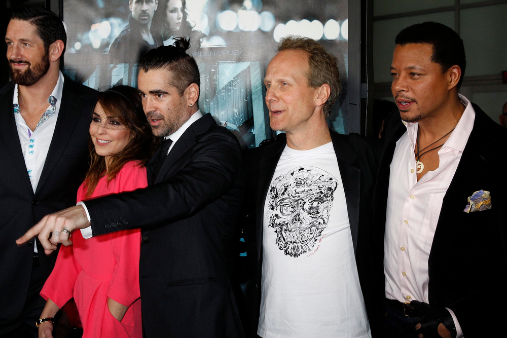 ". The cast and director of the new film ""Dead Man Down\"" (L-R) Wade Barrett, Swedish actress Noomi Rapace, Irish actor Colin Farrell, Danish director Niels Arden Oplev and Terrence Howard pose at the premiere of the film in Hollywood February 26, 2013. REUTERS/Fred Prouser"