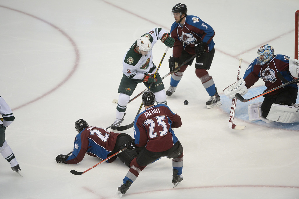 . Charlie Coyle (3) of the Minnesota Wild battles Marc-Andre Cliche (24), Maxime Talbot (25), Nate Guenin (5) and Semyon Varlamov (1) of the Colorado Avalanche during the first period of action.  (Photo by Karl Gehring/The Denver Post)