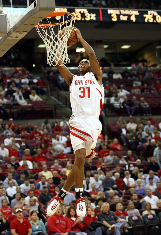 . Ohio State\'s Daequan Cook (31) goes in for a dunk against VMI during the first half of the BCA classic college basketball game, Friday, Nov. 10, 2006, in Columbus, Ohio. Ohio State won, 107-69. (AP Photo/Terry Gilliam)