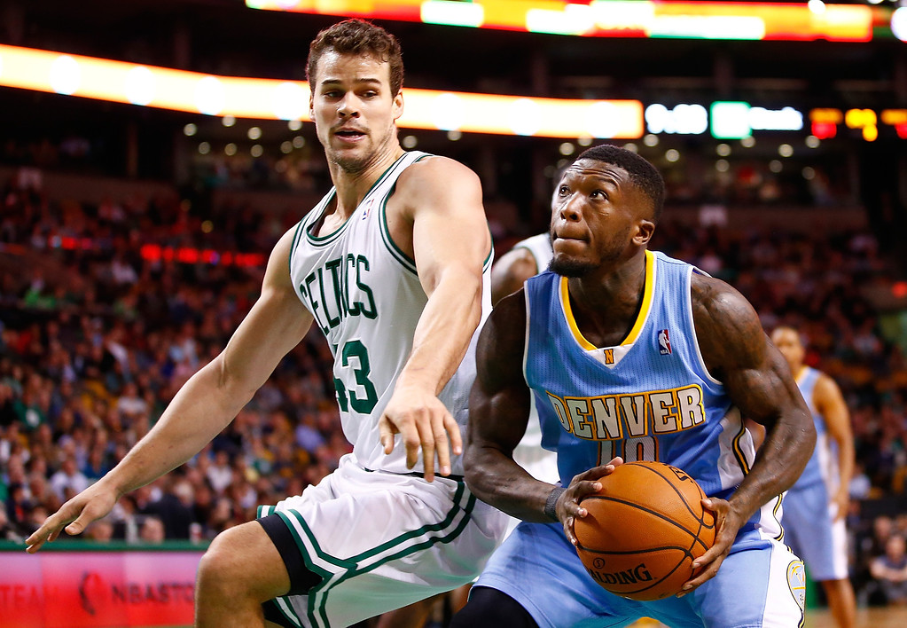 . BOSTON, MA - DECEMBER 06:  Nate Robinson #10 of the Denver Nuggets drives to the basket in front of Kris Humphries #43 of the Boston Celtics in the second half during the game at TD Garden on December 6, 2013 in Boston, Massachusetts.  (Photo by Jared Wickerham/Getty Images)