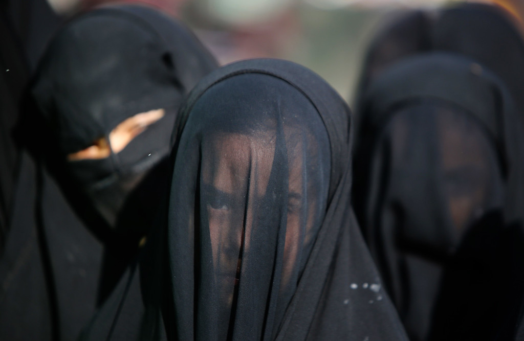 . An Iraqi Shiite girl, whose face is covered with a veil, takes part in a parade in preparation for the peak of the mourning period of Ashura in Baghdad\'s northern district of Kadhimiya on November 1, 2014.  AYEAHMAD AL-RUBAYE/AFP/Getty Images