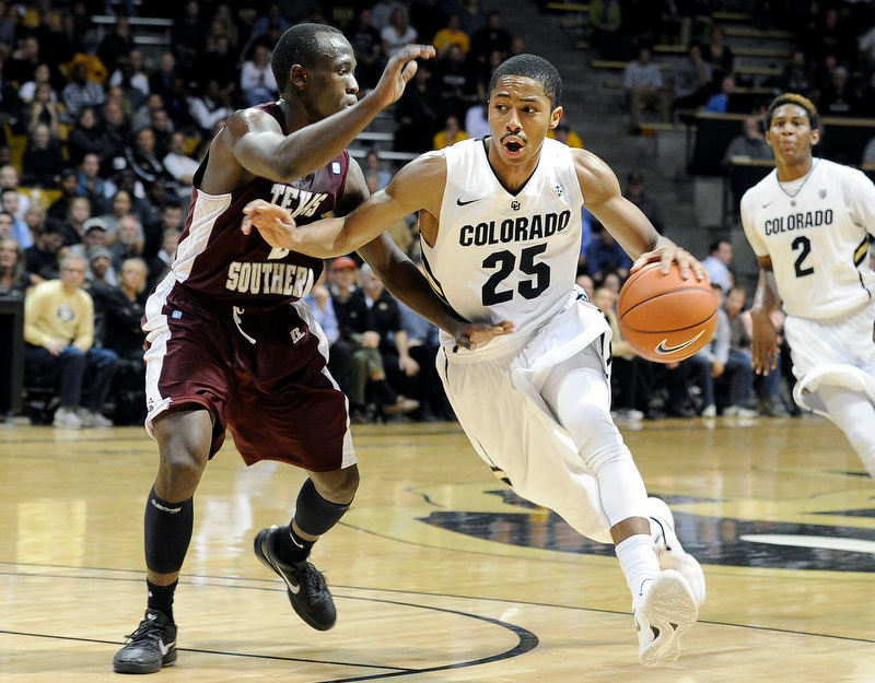 . University of Colorado\'s Spencer Dinwiddie drives the ball past Dexter Ellington during a game against Texas Southern on Tuesday, Nov. 27, at the Coors Event Center on the CU campus in Boulder.  Jeremy Papasso/ Camera