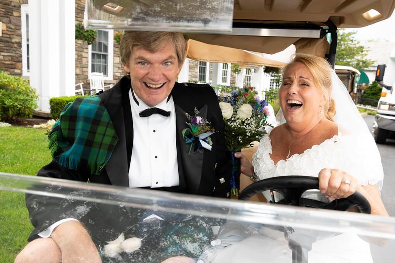 Bride and Groom in golf cart running over jake.jpg