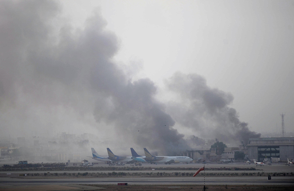 . Smoke rises after militants launched an early morning assault at Jinnah International Airport in Karachi on June 9, 2014.     AFP PHOTO / Rizwan TABASSUM/AFP/Getty Images