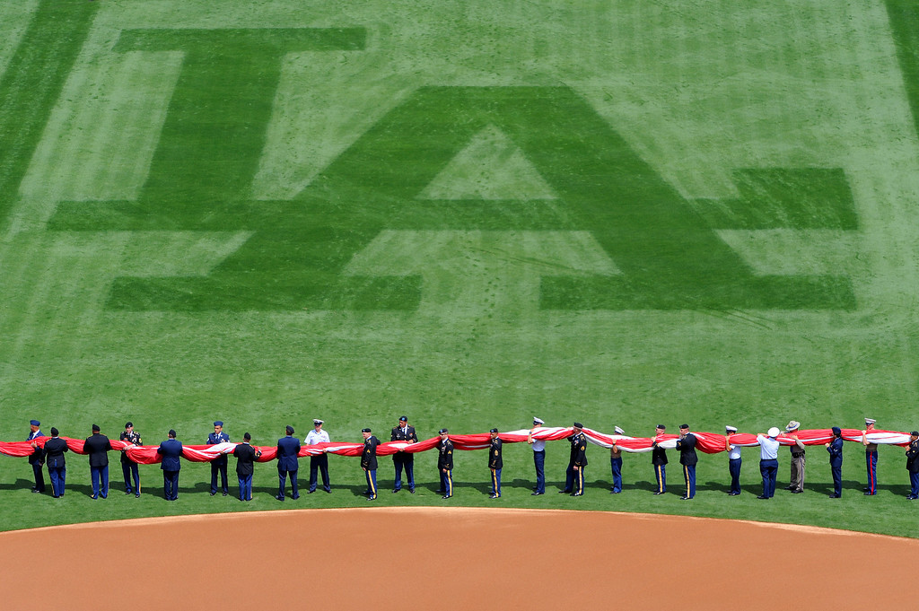 . Military personnel wait to unfurl the flag at the Dodgers home opener, Friday, April 4, 2014, at Dodger Stadium. (Photo by Michael Owen Baker/L.A. Daily News)