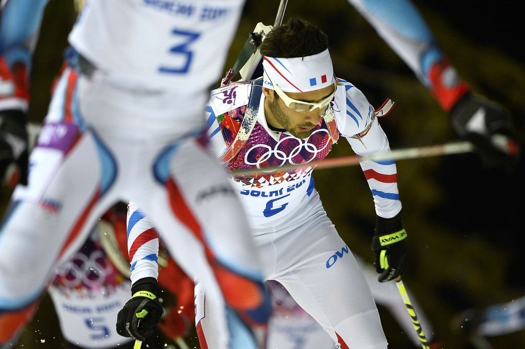 . France\'s Martin Fourcade (C) competes in the Men\'s Biathlon 12,5 km Pursuit at the Laura Cross-Country Ski and Biathlon Center during the Sochi Winter Olympics on February 10, 2014 in Rosa Khutor near Sochi.  PIERRE-PHILIPPE MARCOU/AFP/Getty Images