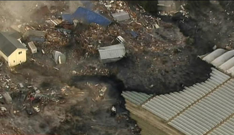 . In this image made off Japan\'s NHK TV video footage, houses are washed away by tsunami in Sendai, Miyagi Prefecture (state) eastern Japan, after Japan was struck by a magnitude 8.9 earthquake off its northeastern coast Friday, March 11, 2011. (AP Photo/NHK TV)
