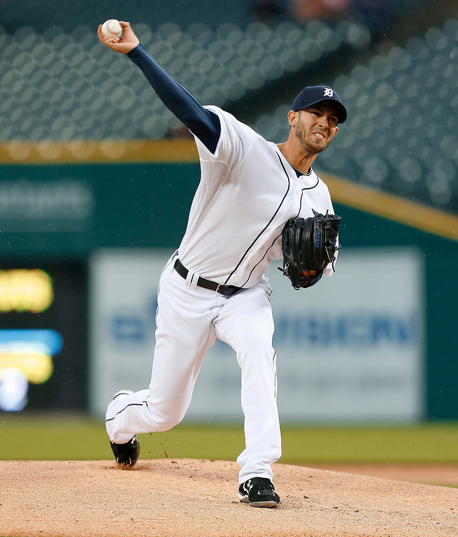 . Detroit Tigers pitcher Rick Porcello throws against the Houston Astros in the first inning of a baseball game in Detroit Wednesday, May 7, 2014. (AP Photo/Paul Sancya)