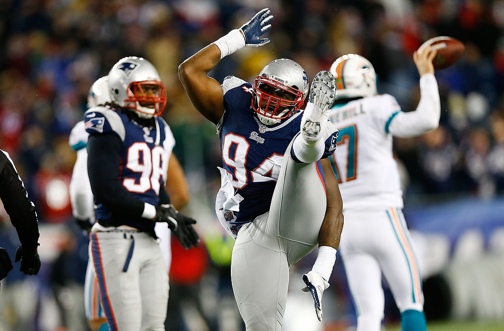 . Justin Francis #94 of the New England Patriots celebrates a sack against Ryan Tannehill #17 of the Miami Dolphins in the second half during the game at Gillette Stadium on December 30, 2012 in Foxboro, Massachusetts. (Photo by Jared Wickerham/Getty Images)