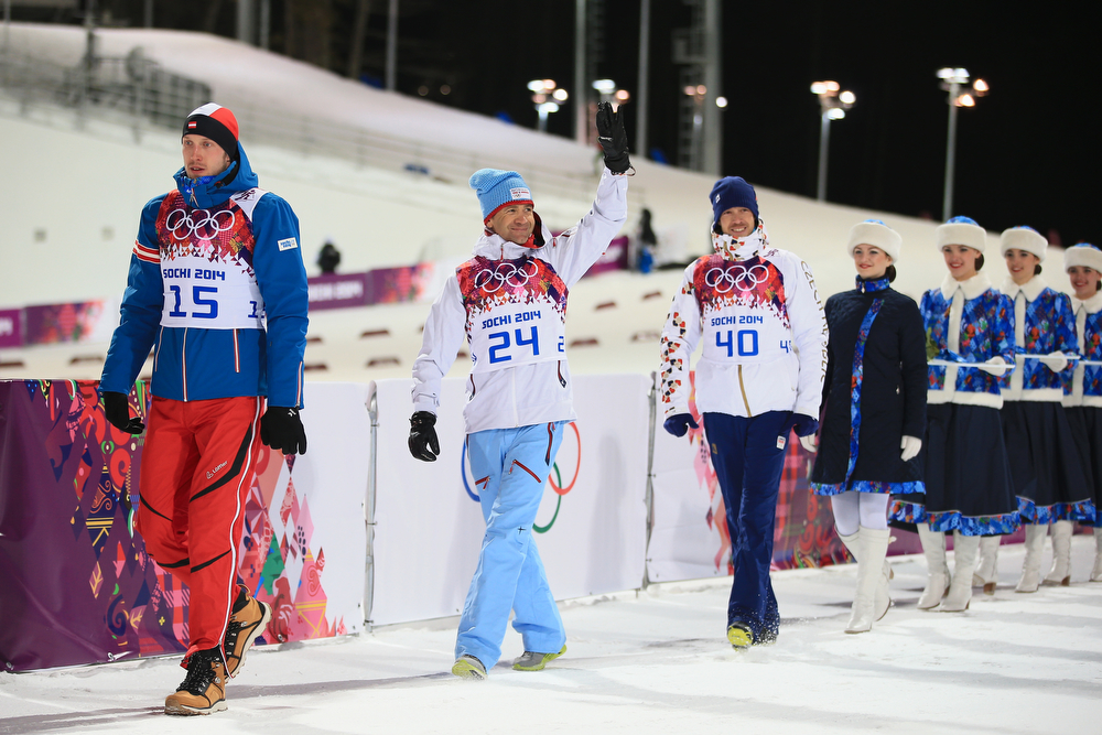 . Gold medalist Ole Einar Bjoerndalen (C) of Norway, silver medallist Dominik Landertinger of Austria (L) and bronze medallist Jaroslav Soukup of the Czech Republic arrive for the flower ceremony for the Men\'s Sprint 10 km during day one of the Sochi 2014 Winter Olympics at Laura Cross-country Ski & Biathlon Center on February 8, 2014 in Sochi, Russia.  (Photo by Richard Heathcote/Getty Images)