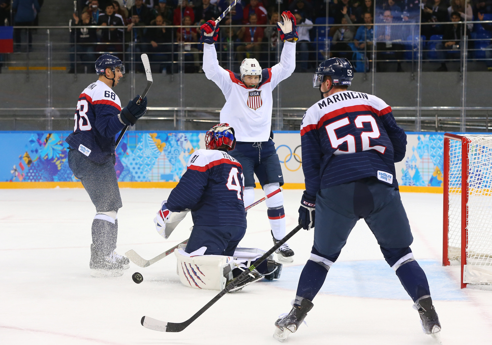 . James van Riemsdyk #21 of United States celebrates after John Carlson #4 of United States scores a goal against Jaroslav Halak #41 of Slovakia in the first period during the Men\'s Ice Hockey Preliminary Round Group A game on day six of the Sochi 2014 Winter Olympics at Shayba Arena on February 13, 2014 in Sochi, Russia.  (Photo by Martin Rose/Getty Images)