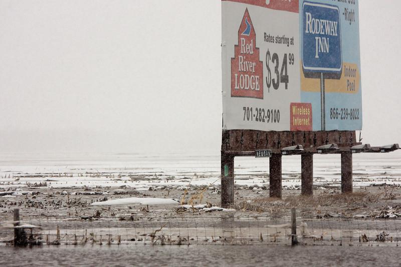 Billboard, mud, water