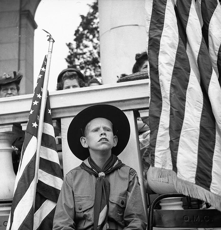 . Arlington Cemetery, Arlington, Virginia. Boy scout color bearer listening to the Memorial Day ceremony, 1943. Bubley, Esther, photographer.  Courtesy the Library of Congress