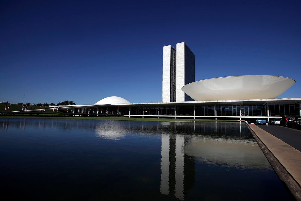 Description of . The Brazilian National Congress designed by architect Oscar Niemeyer is seen in Brasilia. Niemeyer, a towering patriarch of modern architecture who shaped the look of modern Brazil and whose inventive, curved designs left their mark on cities worldwide, died late on December 5, 2012. He was 104. Niemeyer had been battling kidney ailments and pneumonia for nearly a month in a Rio de Janeiro hospital. His death was confirmed by a hospital spokesperson. REUTERS/Ricardo Moraes