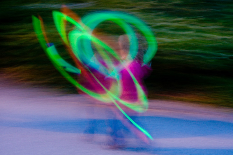 Beverly spins glows sticks on strings