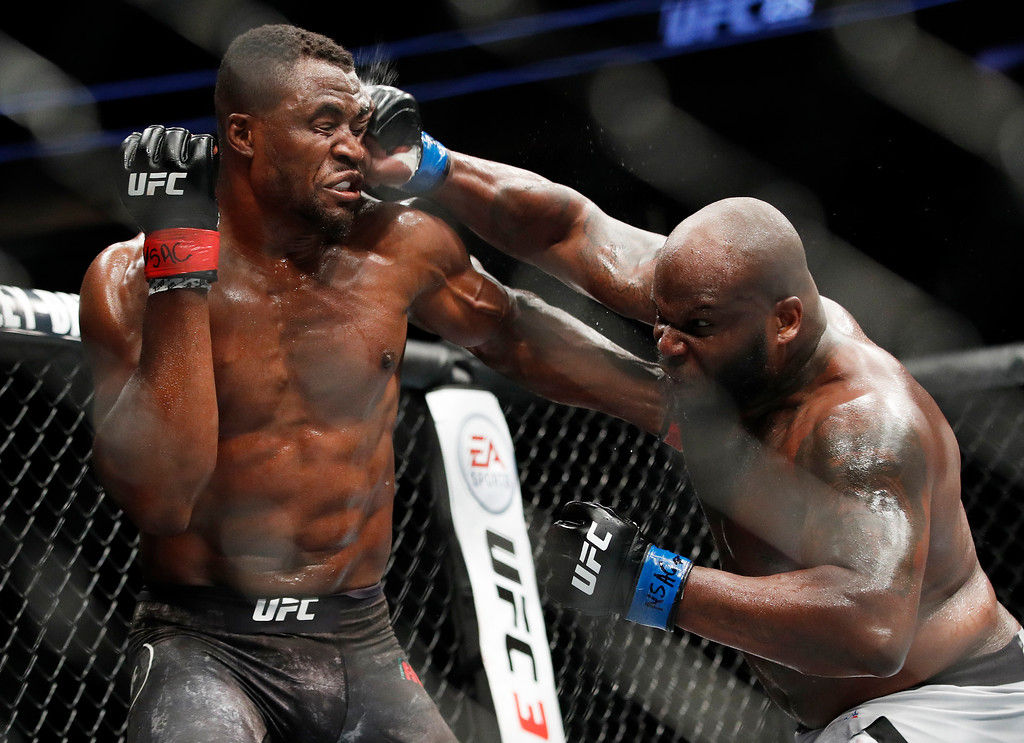 . Derrick Lewis punches Francis Ngannou during a heavyweight mixed martial arts bout at UFC 226, Saturday, July 7, 2018, in Las Vegas. (AP Photo/John Locher)