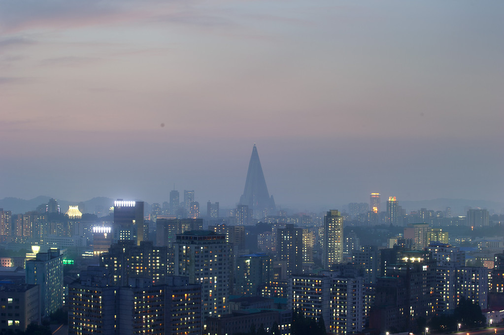. A general view shows the Ryugyong hotel (back C) and the Pyongyang skyline on July 25, 2013. North Korea is preparing to mark the 60th anniversary of the end of the Korean War which ran from 1950 to 1953, with a series of performances, festivals, and cultural events culminating with a large military parade taking place on July 27. AFP PHOTO / Ed JonesEd Jones/AFP/Getty Images
