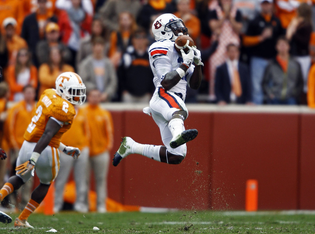 . Auburn defensive back Robenson Therezie (27) intercepts a pass intended for Tennessee wide receiver Pig Howard (2) in the third quarter of an NCAA college football game on Saturday, Nov. 9, 2013, in Knoxville, Tenn. (AP Photo/Wade Payne)