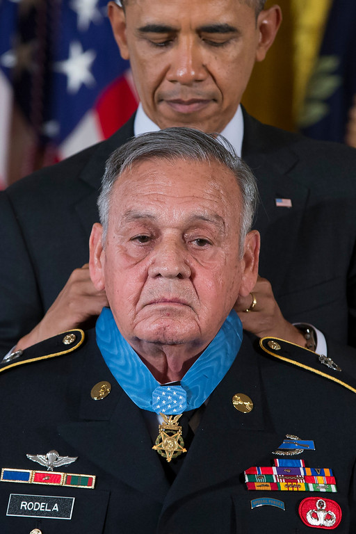 . Sgt. 1st Class Jose Rodela is awarded the Medal of Honor by President Barack Obama during a ceremony in the East Room of the White House in Washington, Tuesday, March 18, 2014. President Obama awarded 24 Army veterans the Medal of Honor for conspicuous gallantry in recognition of their valor during major combat operations in World War II, the Korean War and the Vietnam War. (AP Photo/ Evan Vucci)