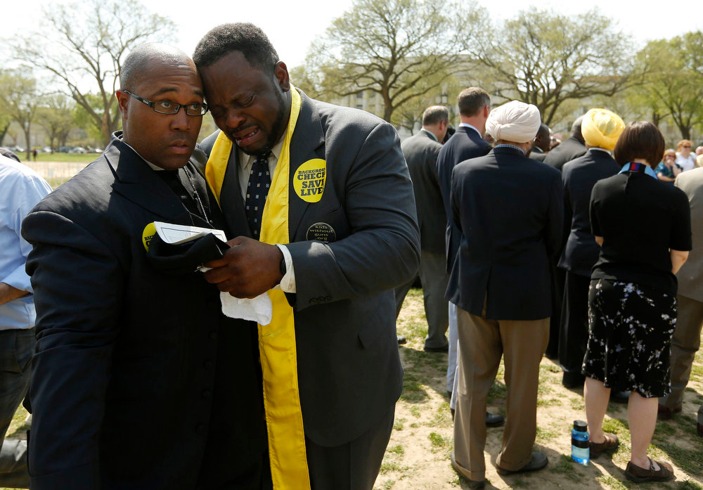 "Description of . A member of the clergy becomes emotional after speaking about gun violence during a prayer service on the National Mall in Washington April 11, 2013. The PICO National Network\'s Lifelines to Healing and Sojourners are holding a 24-hour vigil featuring a gathering of Newtown clergy and 3,300 grave markers to ""remind Congress action is needed on gun violence prevention\"". The number 3,300 represents the supposed number of people who have died as a result of gun violence since the tragedy in Newtown.   REUTERS/Kevin Lamarque"