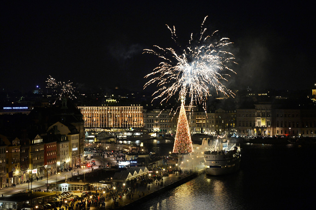 . Fireworks explode over the Skepsbron street during the New Year\'s Eve celebration in central Stockholm, Sweden at midnight Tuesday, Dec. 31, 2013. (AP Photo/TT News Agency, Anders Wiklund)