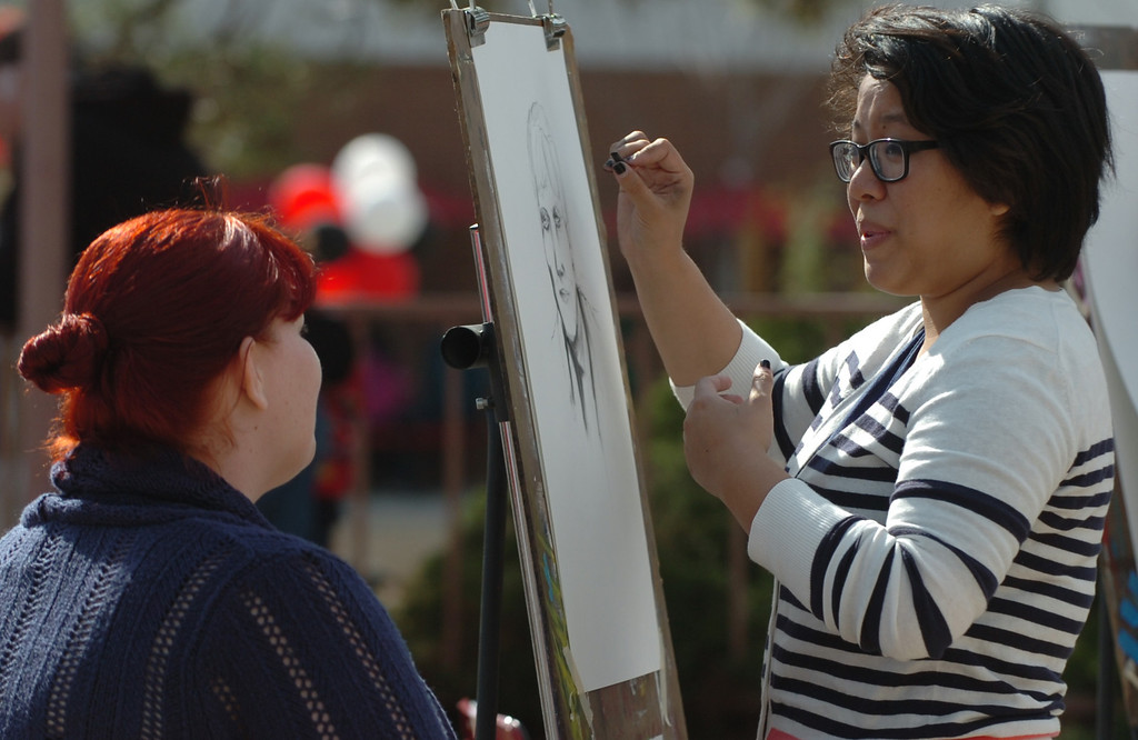 . Former Chaffey College student Camille Alaras, right 22 of Rancho Cucamonga, draws student Melissa Garcia, 30 of Upland, at the Chaffey College celebrates its �130th� anniversary in Rancho Cucamonga March 9, 2013. (Thomas R. Cordova/Staff Photographer)