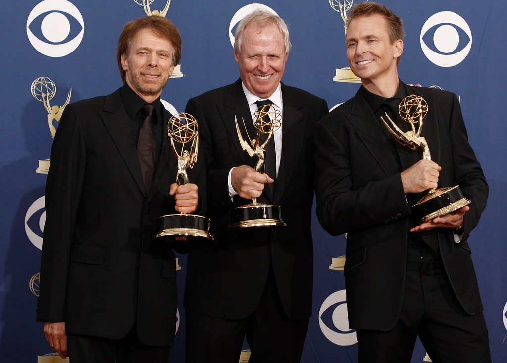 ". Executvie pruducers from left,  Jerry Bruckheimer,  Bertram van Munster, center, and host Phil Keoghan pose with the award for outstanding reality-competition program for ""The Amazing Race\""  backstage at the 61st Primetime Emmy Awards on Sunday, Sept. 20, 2009, in Los Angeles. (AP Photo/Matt Sayles)"