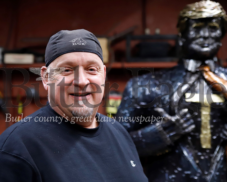 Bill Secunda, local metal works artist, with his Trump scupture. Seb Foltz/Butler Eagle