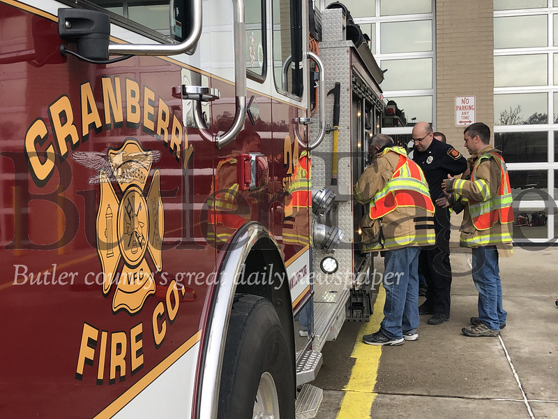 Photos by J.W. Johnson Jr.1-2: Members of the Cranberry Volunteer Fire Department check equipment Friday at the Haine Station.