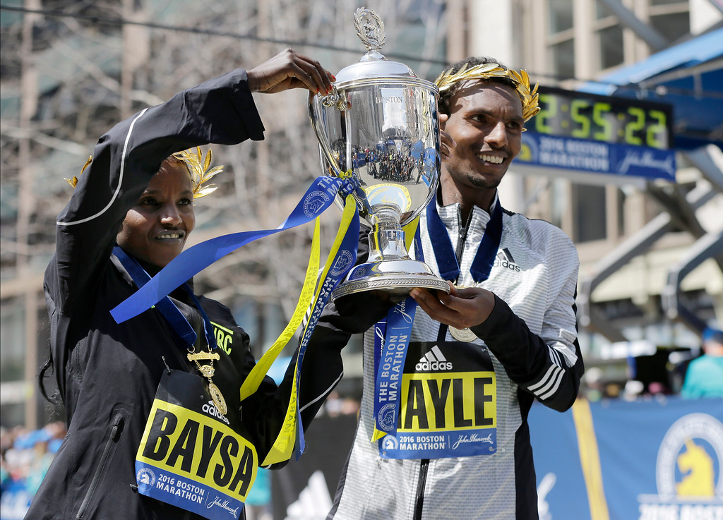 . Atsede Baysa, left, and Lemi Berhanu Hayle, both of Ethiopia, hold a trophy after they won the women\'s and men\'s divisions of the 120th Boston Marathon on Monday, April 18, 2016, in Boston. (AP Photo/Elise Amendola)