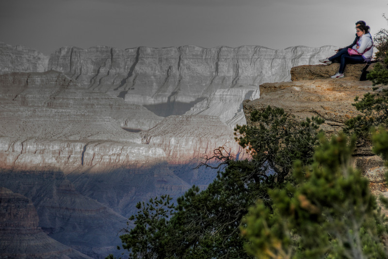 Sitting on a rock cliff at Grand Canyon National Park in Arizona, USA
